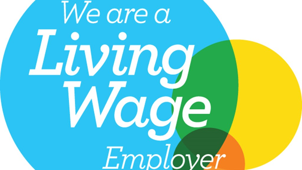 PIG'S EARS CELEBRATES LIVING WAGE COMMITMENT